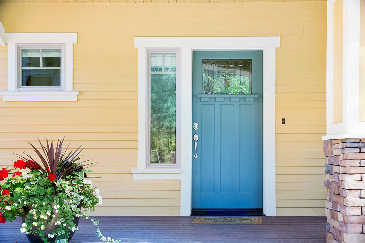 An image of teal coloured front door.