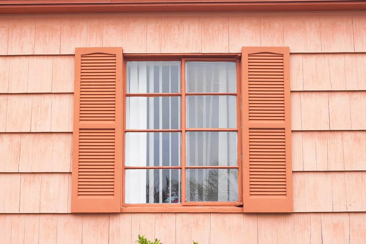 A set of window shutters on a house.