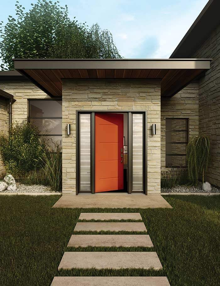 An orange front door on a beautiful, modern home.