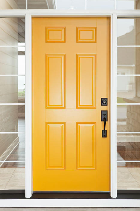 Interior view of a yellow steel entry door by Northern Comfort Windows and Doors.