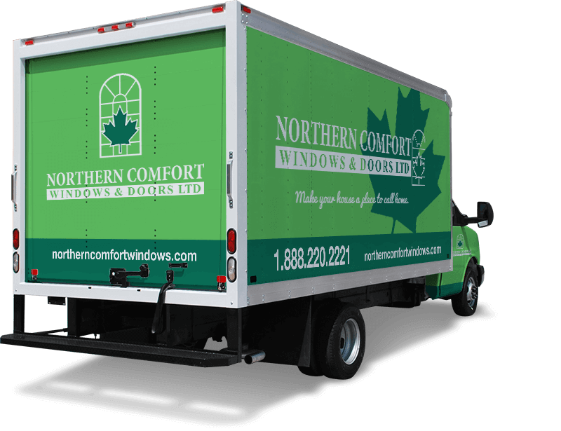 A green truck with Northern Comfort Windows and Doors Branding on it.