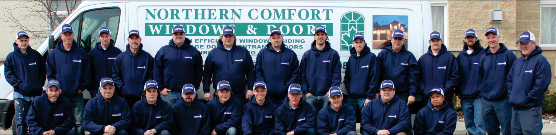 A group of window, door, and garage door installers.