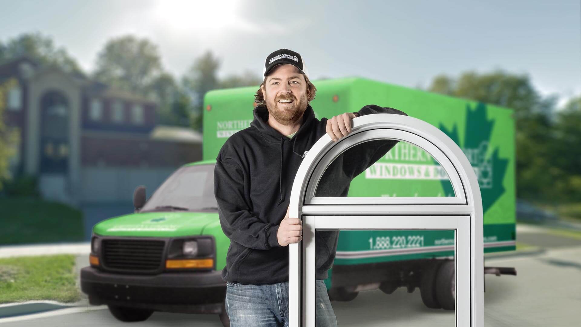 A Northern Comfort installer standing in front of a truck.