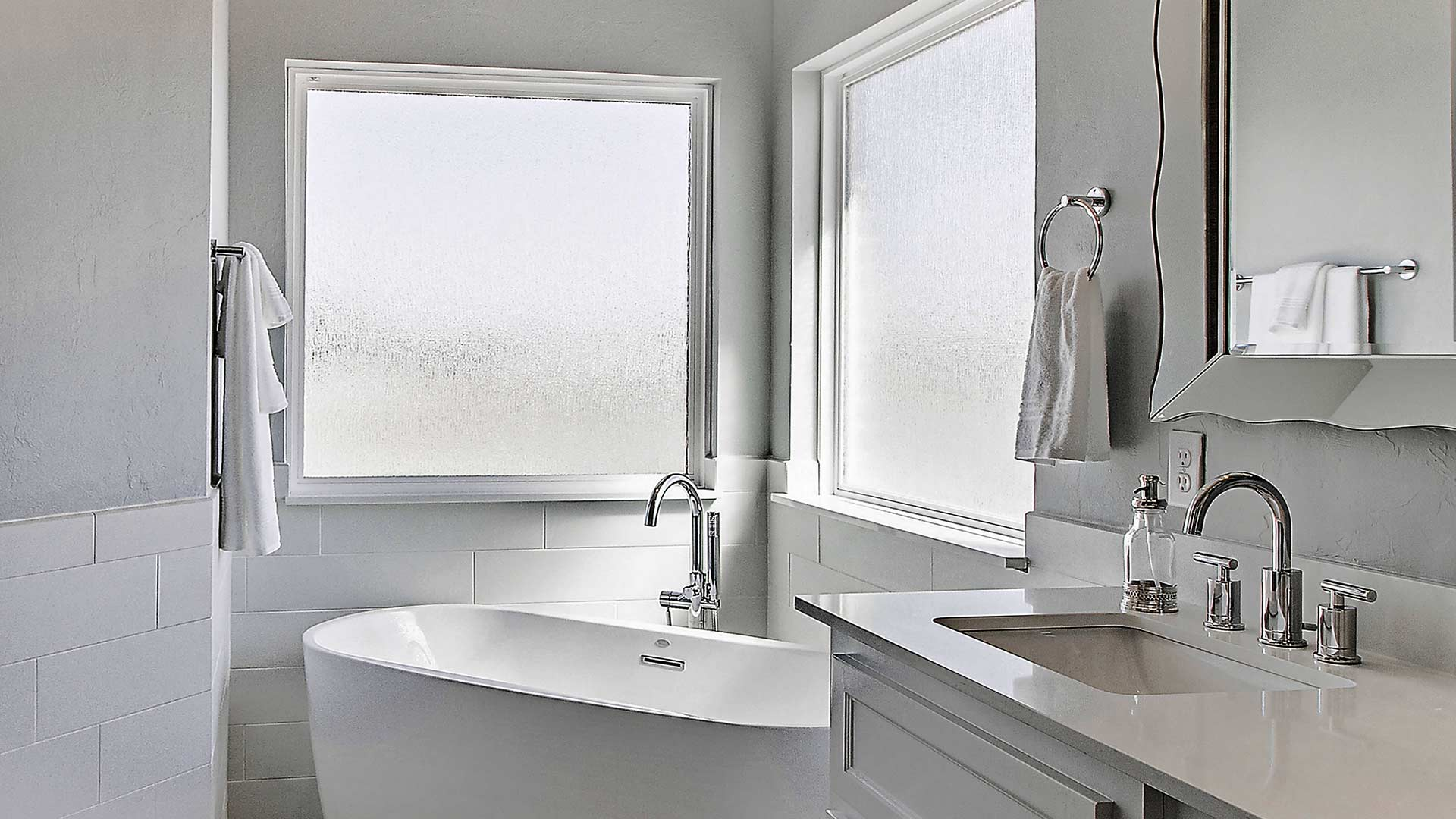 A bathroom window with specialty frosted privacy glazing.