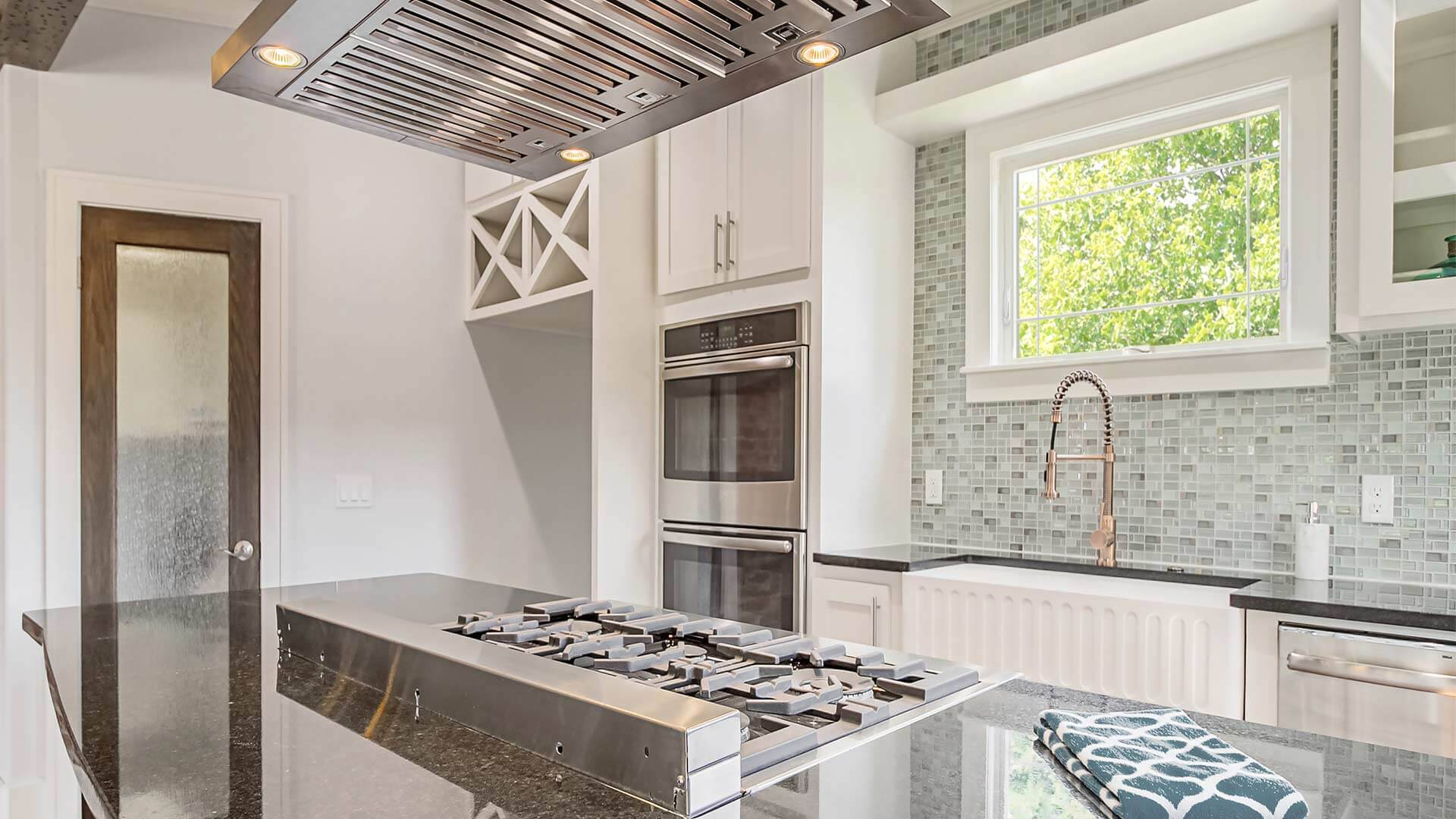 Modern renovated kitchen with a Classic Series Awning Window.