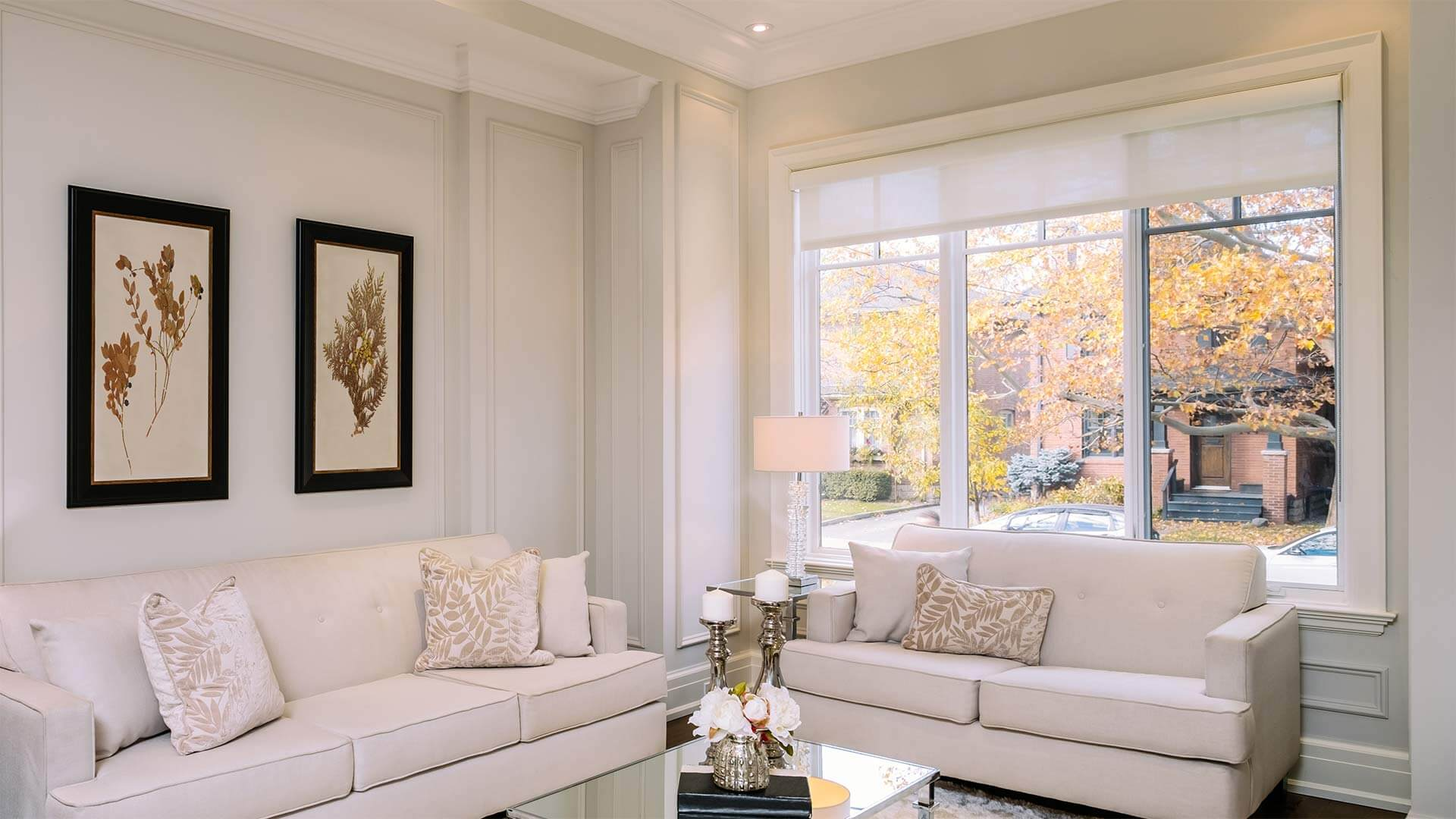Stylish and bright living room a with large triple-lite casement window.
