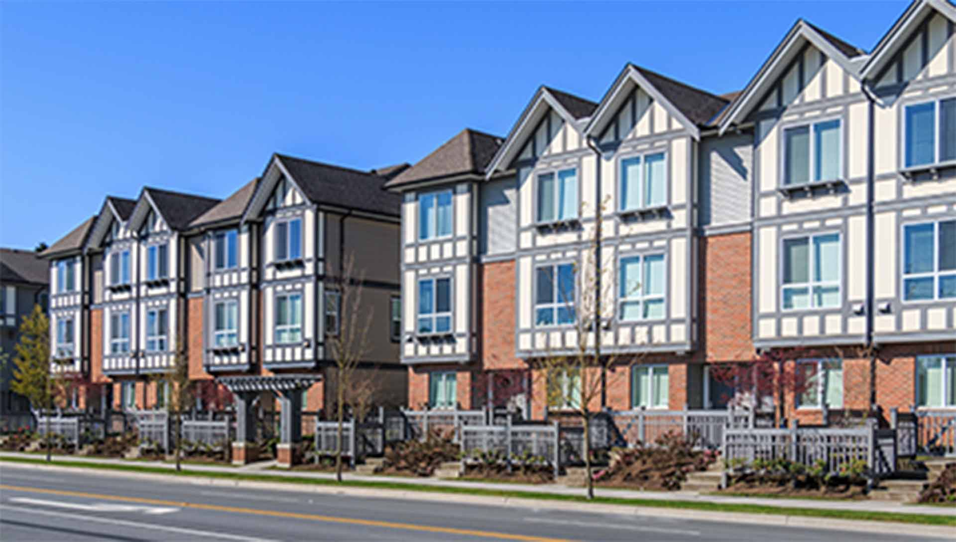 A photo of a row of town home condos that have Northern Comfort Windows and Doors Installed.