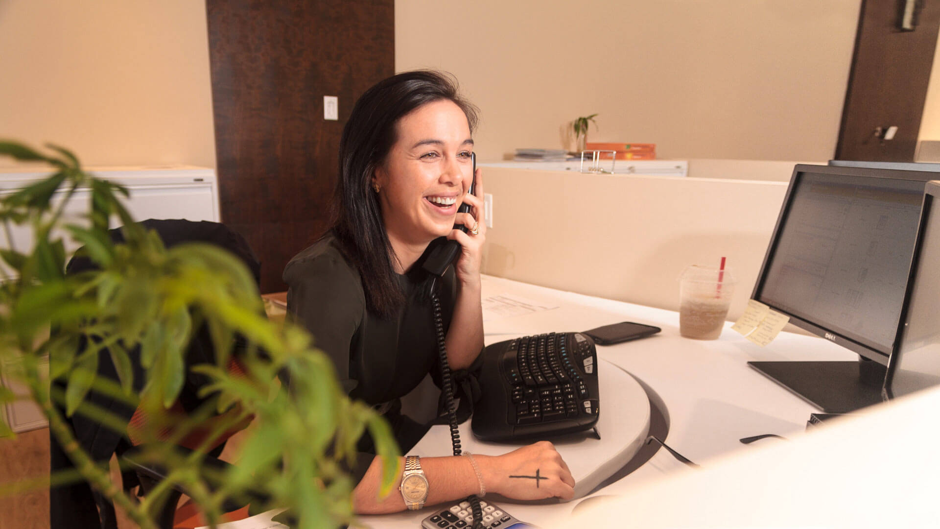 A Northern Comfort Customer Service Representative talking to a customer on the phone.