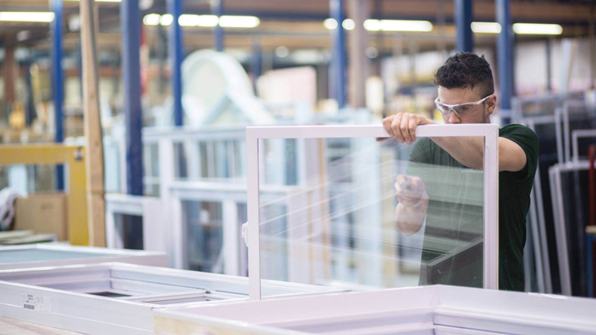 A Northern Comfort window builder working on the the factory floor.