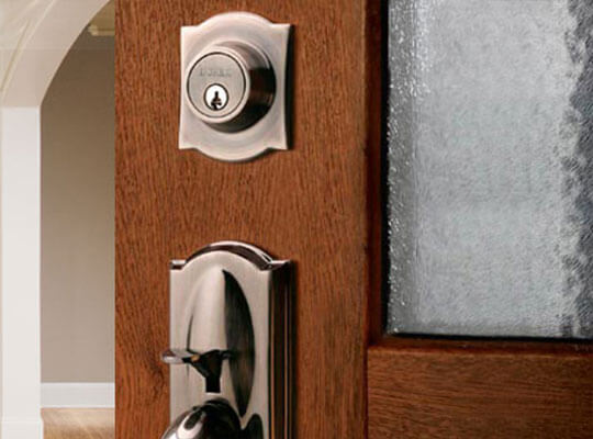 A close-up view of entry door handle and lock