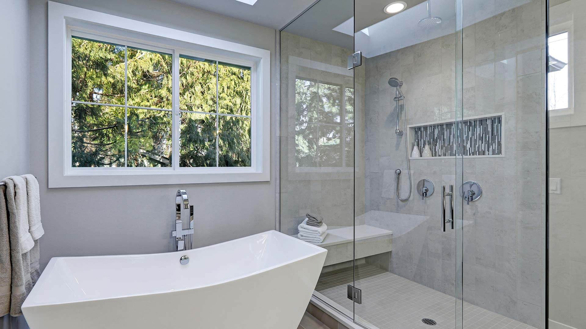 Modern renovated bathroom with a Classic Series Double Slider Window.