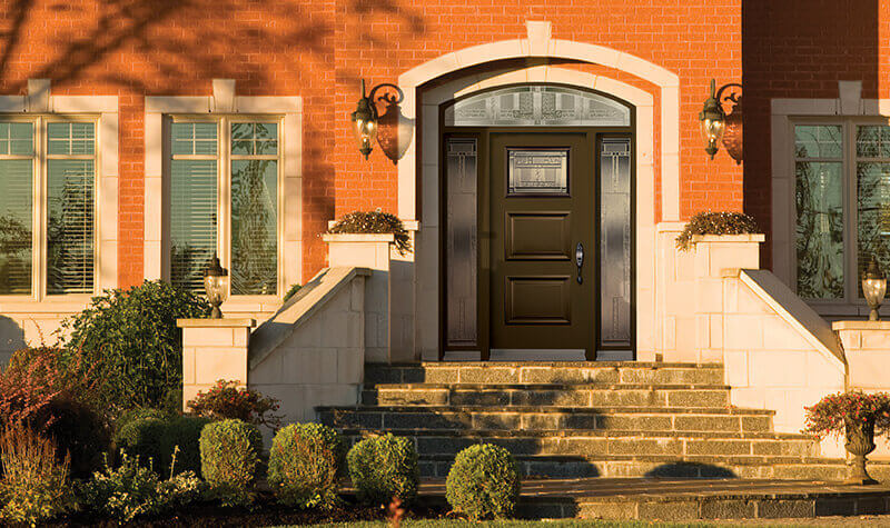 Modern steel entry door with extended arch transom
