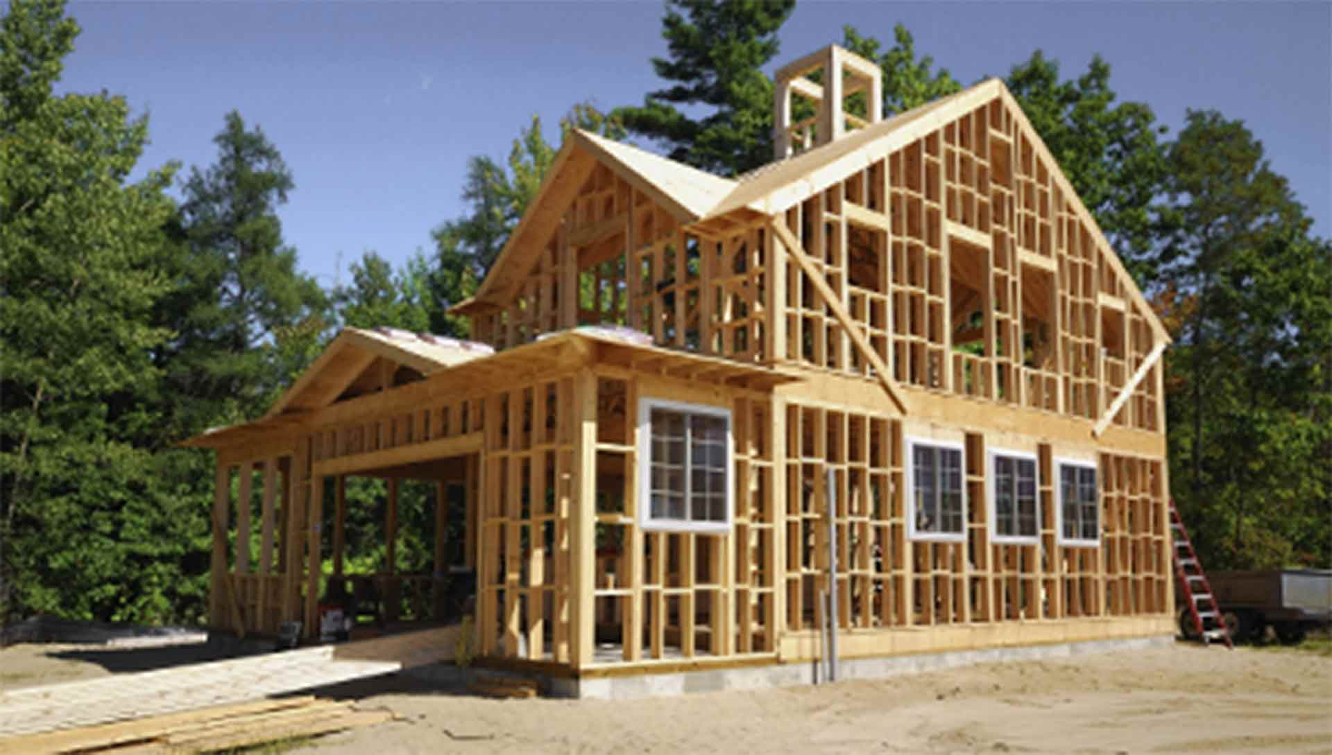 A photo of a house that has been framed, ready for installation of windows and doors.