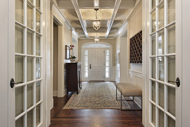 A photo of French doors opened leading into a hallway