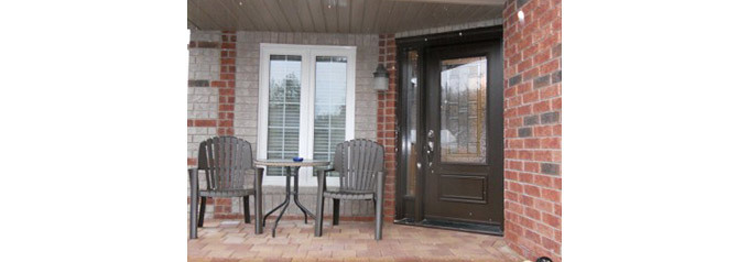 brown fibreglass door to front porch
