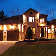 luxury home lit up at night