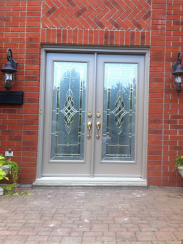 double steel entry doors in brick house