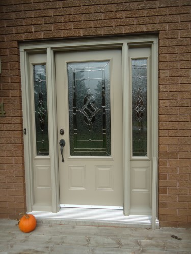 tan steel door with tall windows on either side