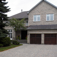 home with two carriage style garage doors