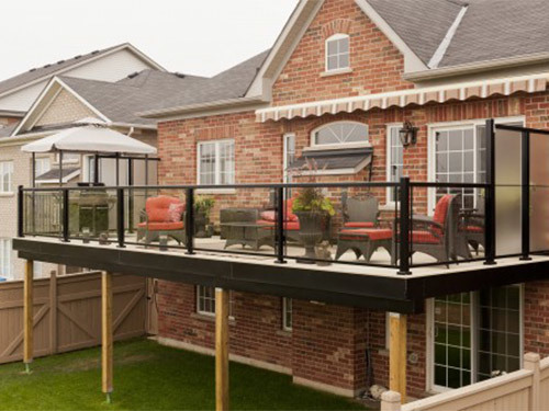 black railing with glass on patio