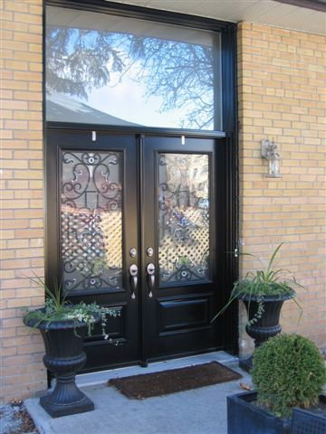 double steel entry doors with large window overhead
