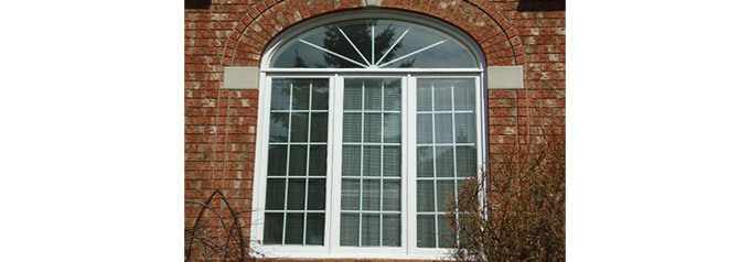 arched window on brick house
