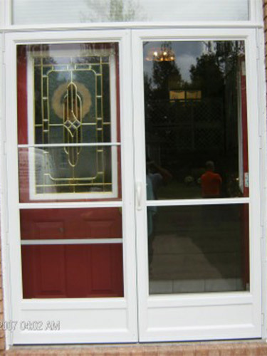 white storm doors over red entry door