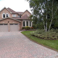 Brick home with bow windows